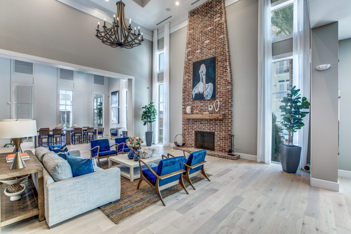 resident lounge with fireplace in luxury houston texas apartment