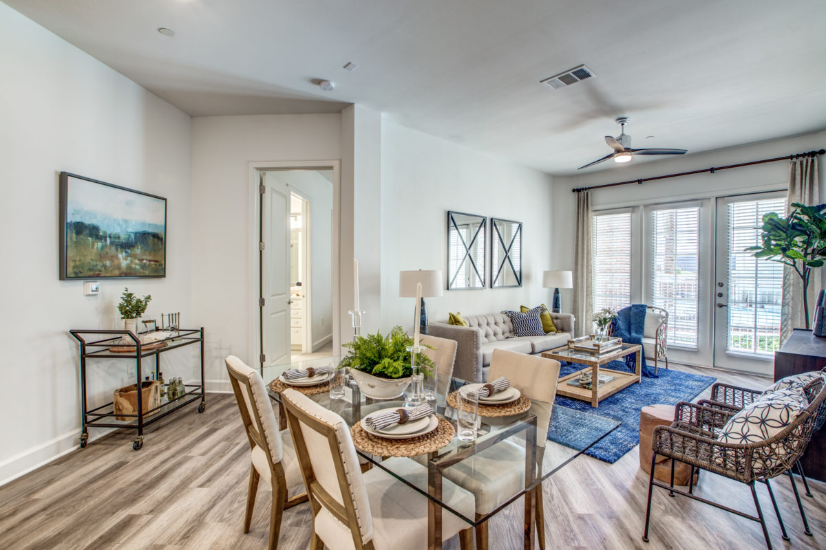 dining area and living room in luxury houston texas apartment