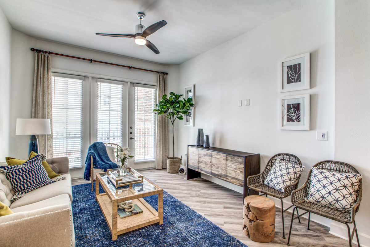 living room with remote controlled ceiling fans in luxury houston tx apartment