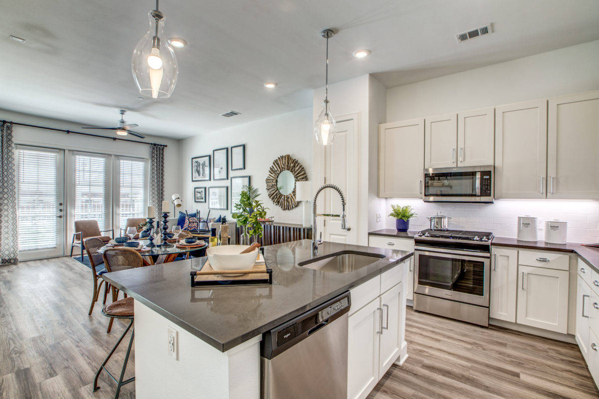 butcher block islands and dark gray quartz counters in luxury houston tx apartment